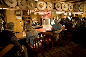 The bar inside The Ore House, in Santa Fe, New Mexico. Cool hats!