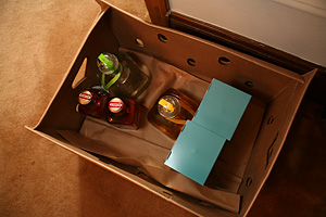 The box of tequila, containing 2 bottles each of Don Julio Anejo and Herradura Anjeo, plus Patron Anjeo and Reposado.