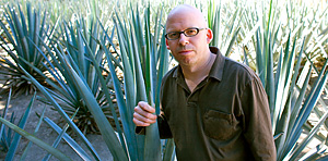 Grover and a blue agave plant in Tequila, Jalisco, Mexico.