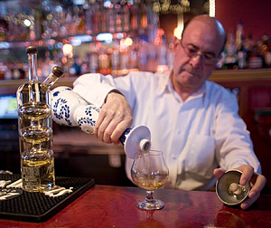 Armado pours up a healthy shot of Clase Azul Añejo, which Grover consumed, along with a shot of Sangrita.