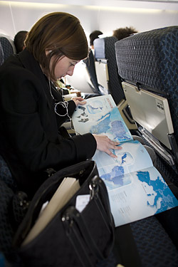 Scarlet reading a map of Mexico just prior to landing in Guadalajara, Mexico.