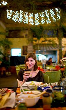 Scarlet, sitting in the Casa Fuerte courtyard, drinking a Tamarind Margarita.