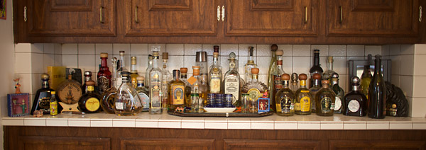 "(Left to Right) Tequila Lapis Anejo; mini-bottle Gusano Rojo Mezcal Joven w/worm; ""Scarlet y Grover"" mini-barrel - a gift from Tequilas de Senor distillery; Aha Toro Anejo; Don Julio Anejo; Pueblo Viejo Anjeo; Tequila Castelan Anejo; Tequila Esperanto Select Anejo; Centinella Anejo; Tequila Ocho Anejo; Tequila El Mayor; Tequila Castelan Reposado; La Cava de Mayoral blanco; Tequila Oro Azul; El Tequileño Reposado; Cazadores Anejo; Herradura Anejo; Gran Centenario Reserva del Tequilero; Partida Anejo; Dos Lunas Anejo; Gran Centenario Anejo; Pueblo Viejo Orgullo; Tequila Fortaleza; Heradura Seleccion Suprema; El Diamonte del Cielo; Gran Centenario Leyenda; Don Julio 1942; Maestro Tequila Anejo; Siete Leguas Anejo; Don Julio Real; Siete Leguas Reposado; Siete Leguas Blanco; Tres Manos Anejo; Tequila D'Antaño (Siete Leguas extra anejo); Casa Noble Blanco; Casa Noble Anejo; TKO blanco; a bottle of partially consumed JR Storey wine; Tequila Stallion anejo. Not shown (because the bottle is too damn tall) Clase Azul anjeo."
